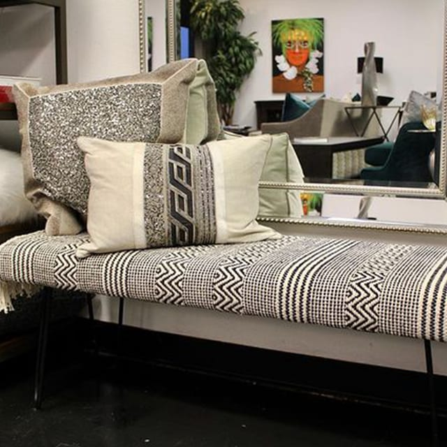 Unique print on bench with embellished pillows